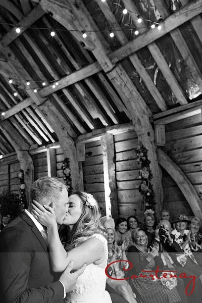 bride kisses groom during marriage ceremony