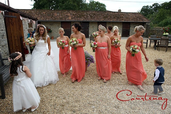 large bridal party walk together