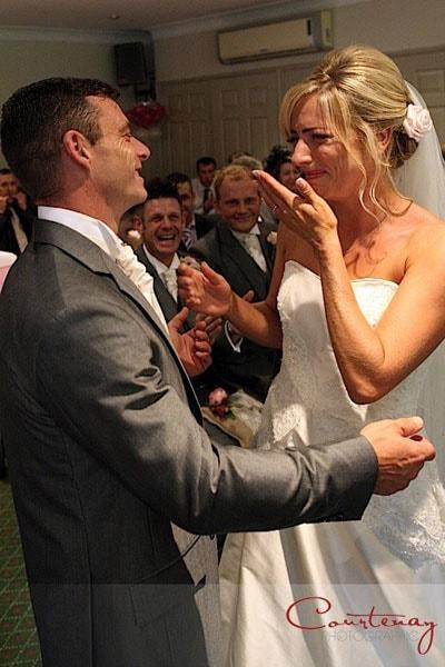 bride cries during wedding ceremony