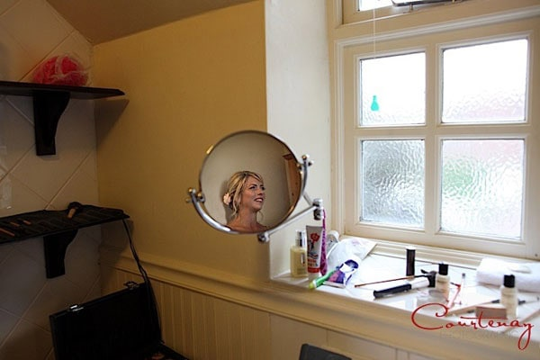 bride-reflected-in-circle-mirror