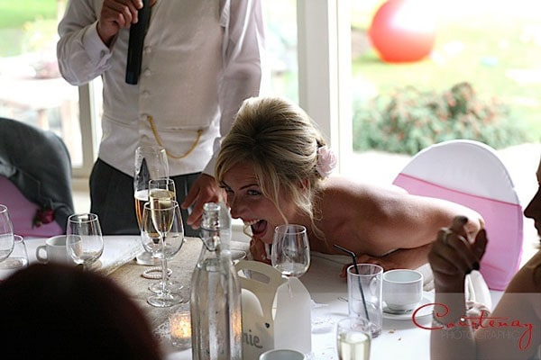 bride screams with laughter at speech