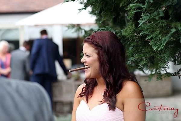 bridesmaid smoking cigar