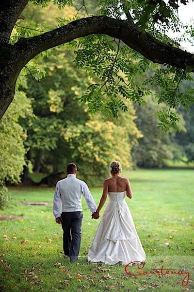 bride groom walk holding hands