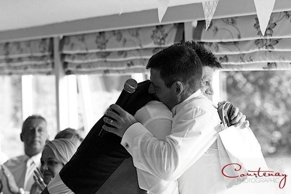 groom hugs best man
