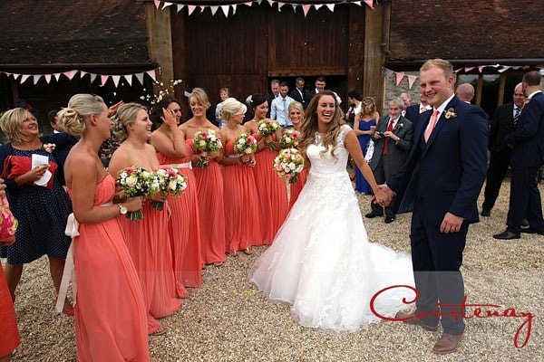 bride and groom greet bridesmaids happily