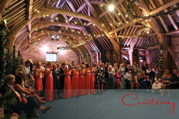 adult bridesmaids line up in barn wedding