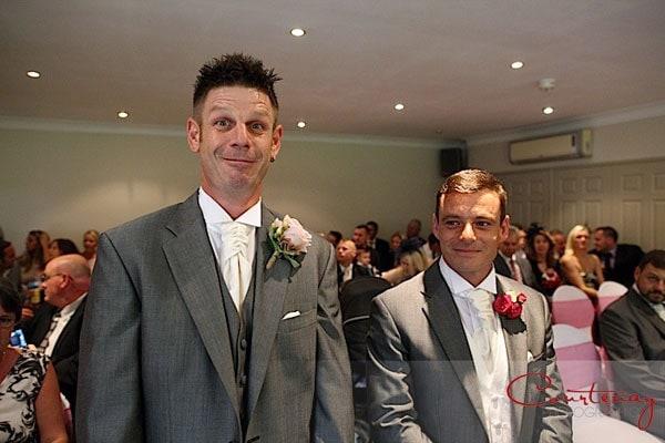 tall goofy best man beaside groom