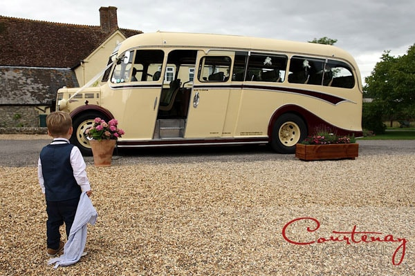 cream vintage bus which toddler boy watches