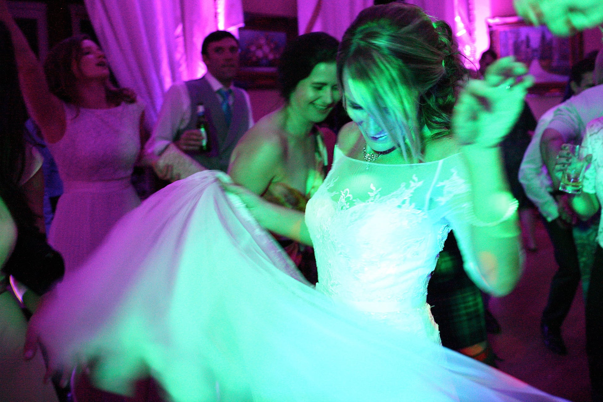 bride-dancing-coloured-lights