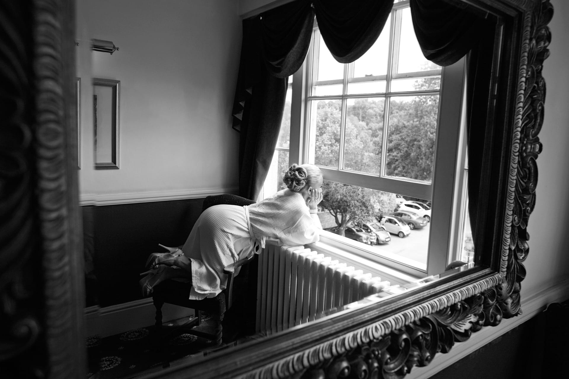 bride-kneeling-on-chair-reflection