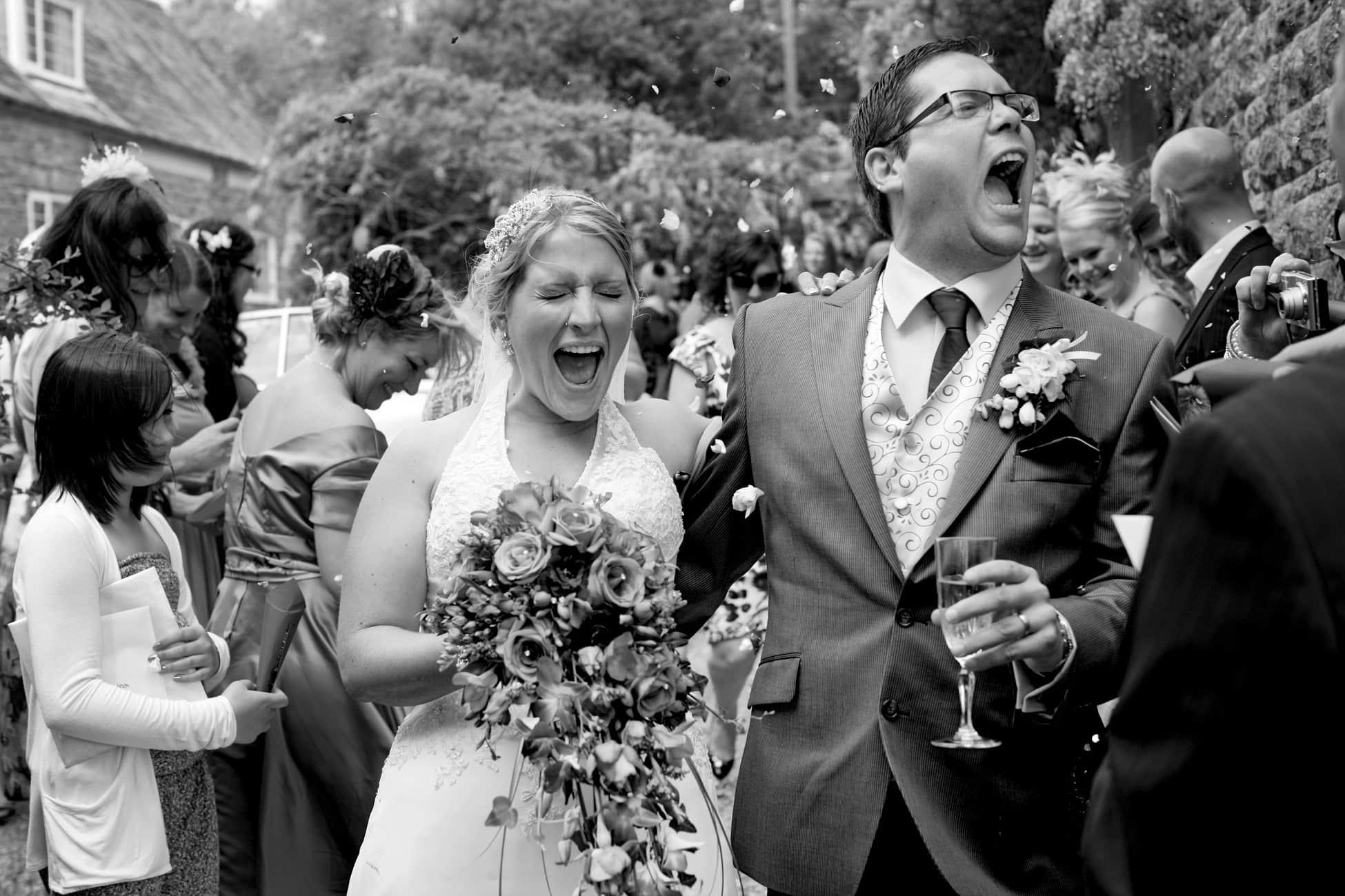 classic-bride-and-groom-in-confetti