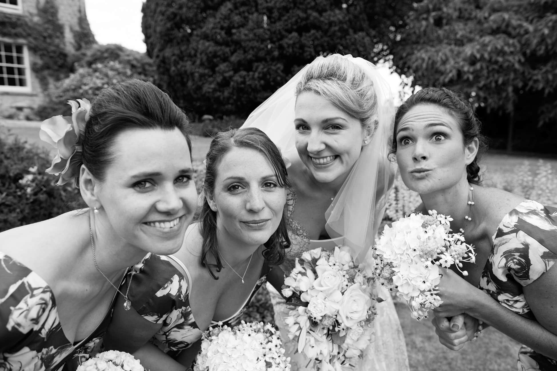 funny-bride-and-bridesmaids-pose