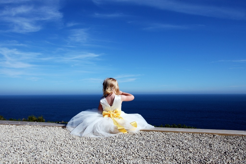 little bridesmaid in white dress with yellow sash