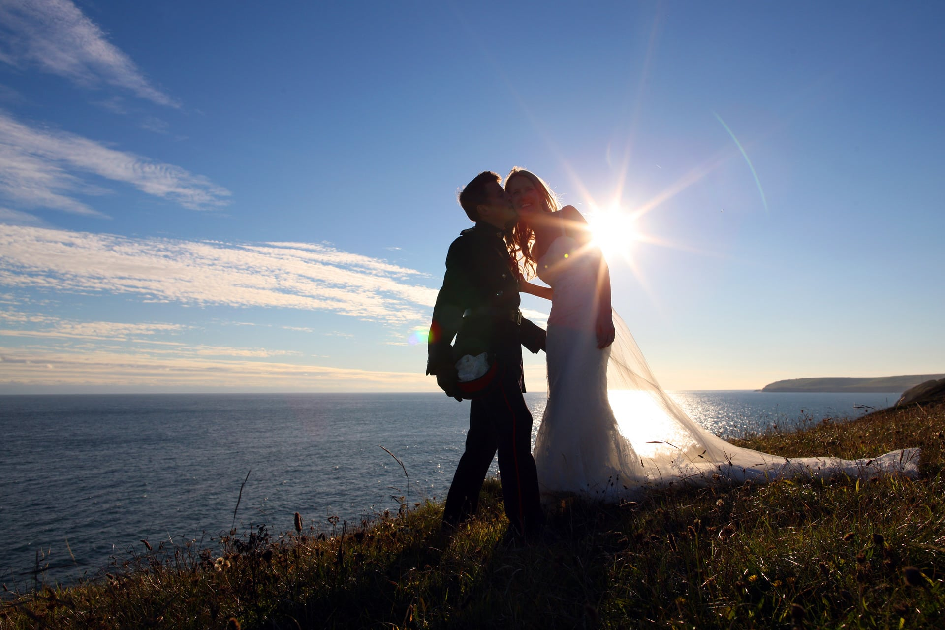 soldier-kisses-bride-on-clifftop-as-sun-sets