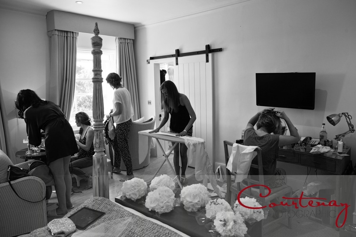 bride and bridesmaids get ready for wedding