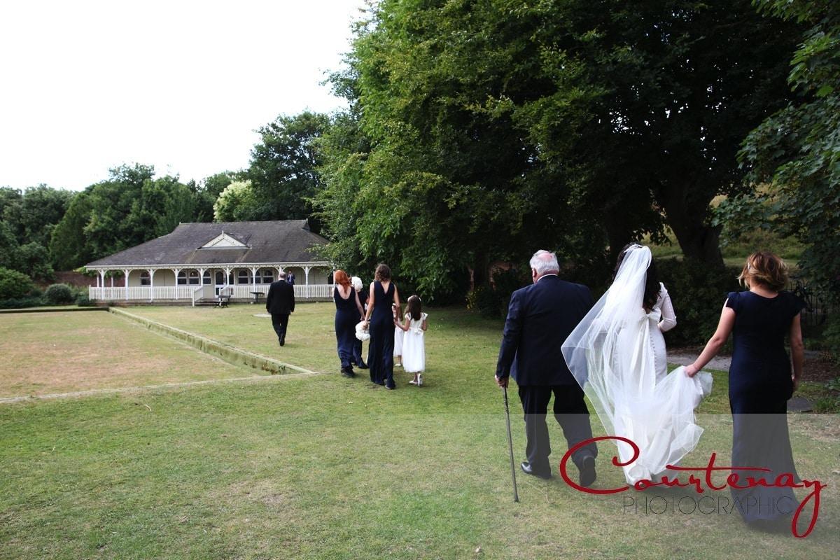 bride and dad walk to ceremony