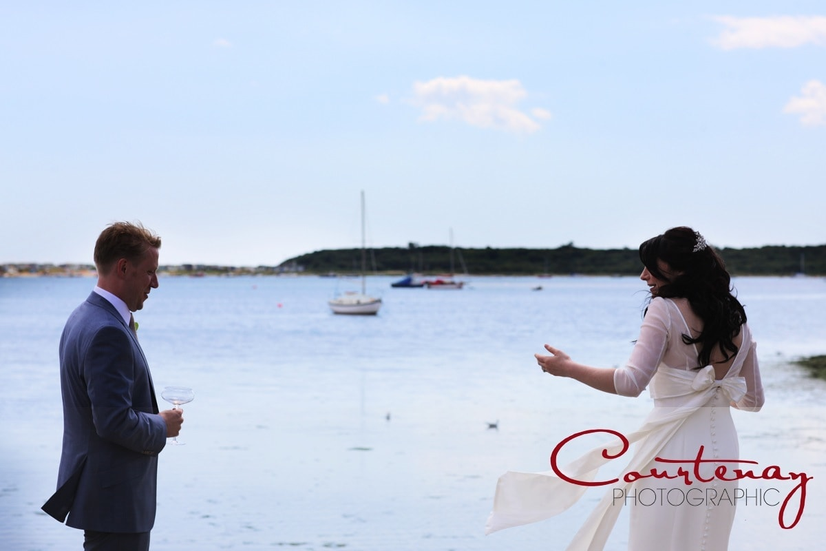 bride and groom by the sea