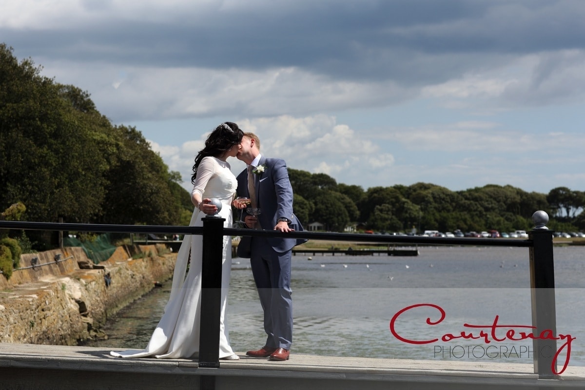 happy couple kiss by the sea