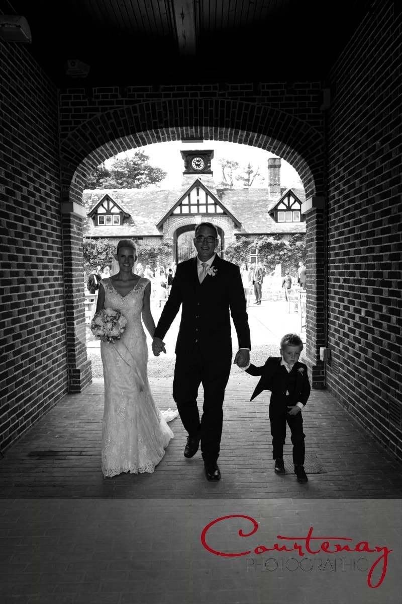 bridal family exit through tunnel