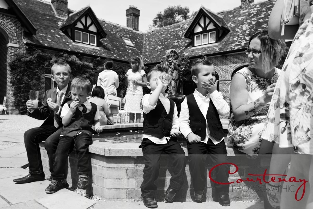 young lads enjoy a wedding drink