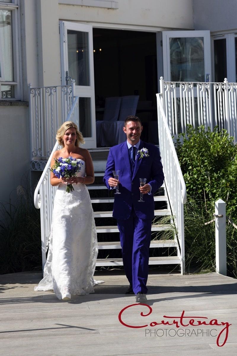 bride and groom enter enter gardens