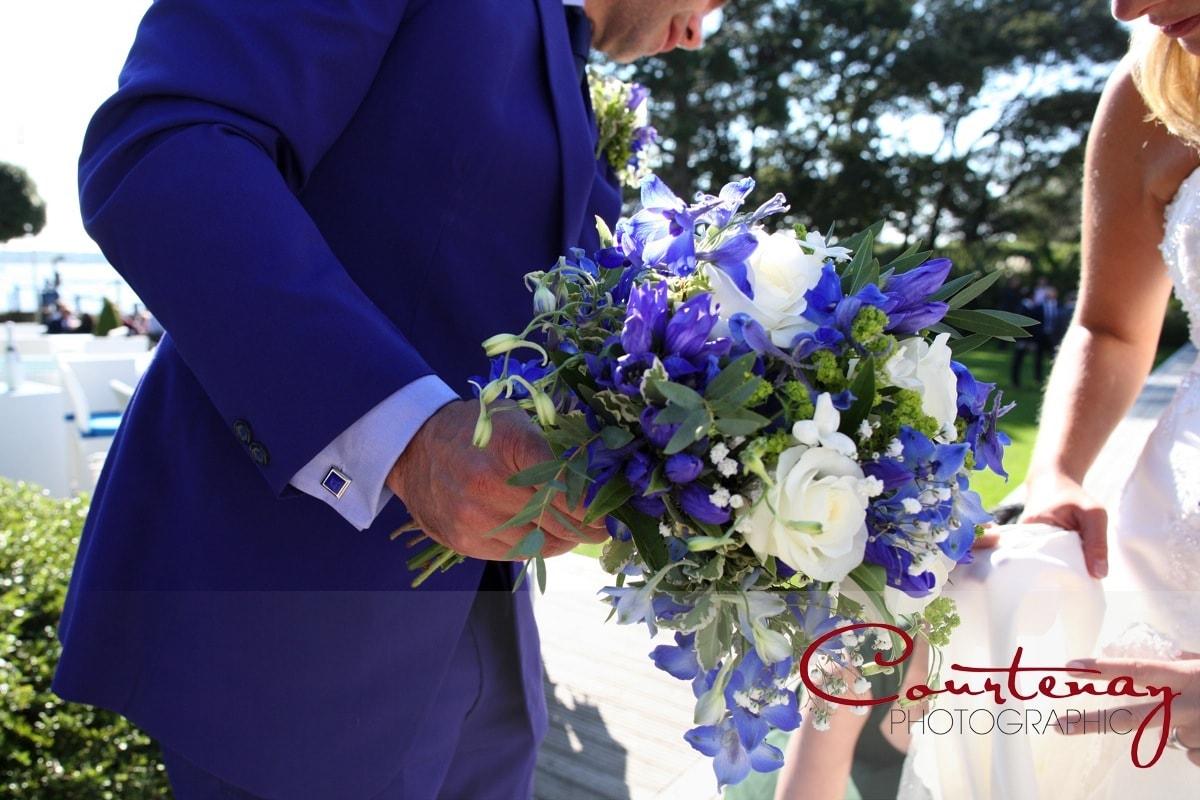 brides flowers held by the groom