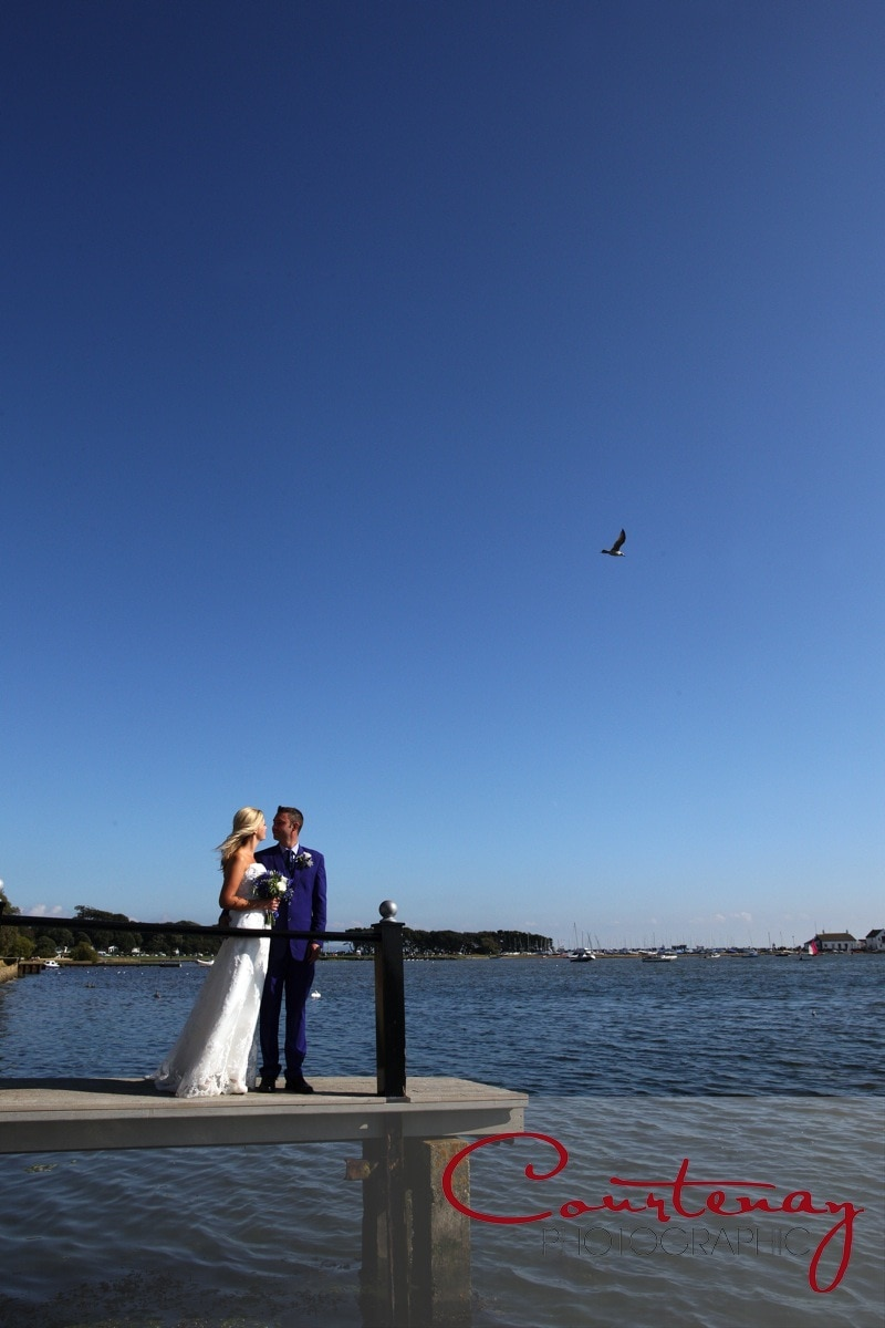 bride and groom on hotel jetty