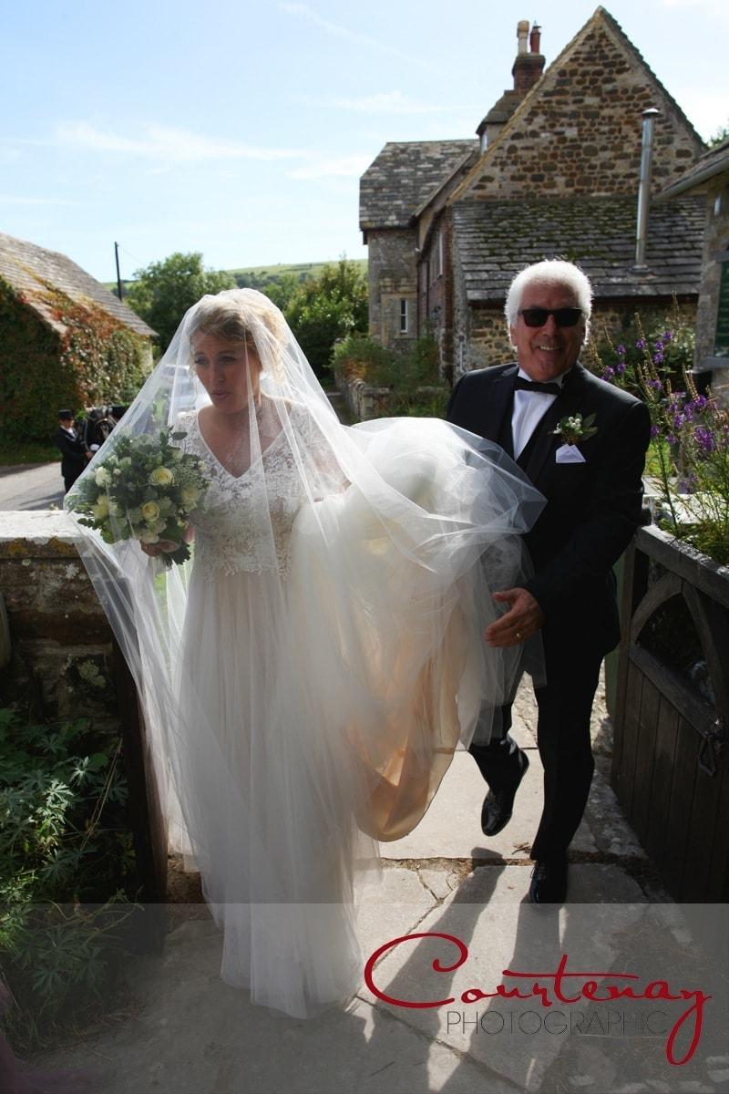 dad escorts the bride