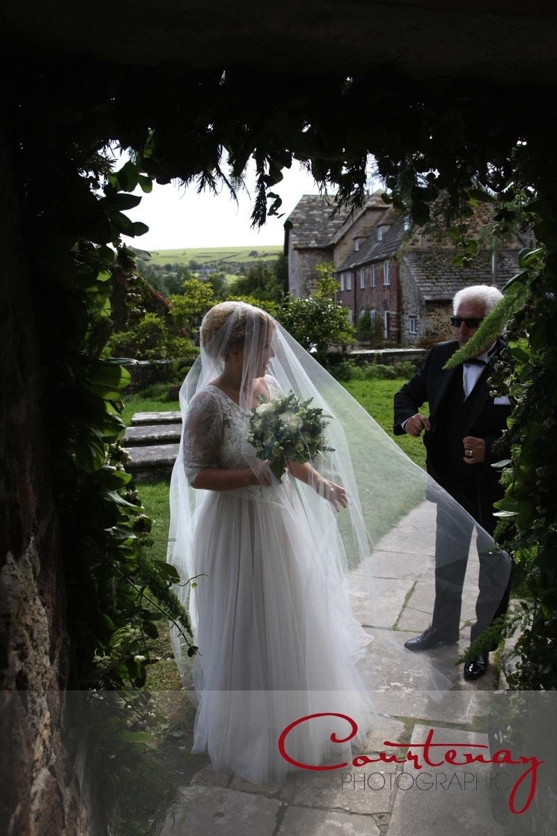 bride and dad prepare to enter church