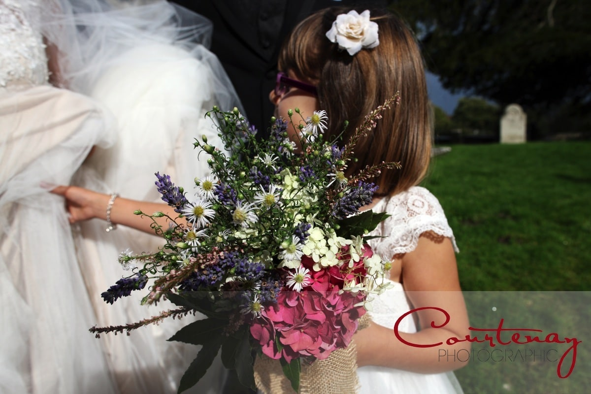 bridesmaid holds all the flowers