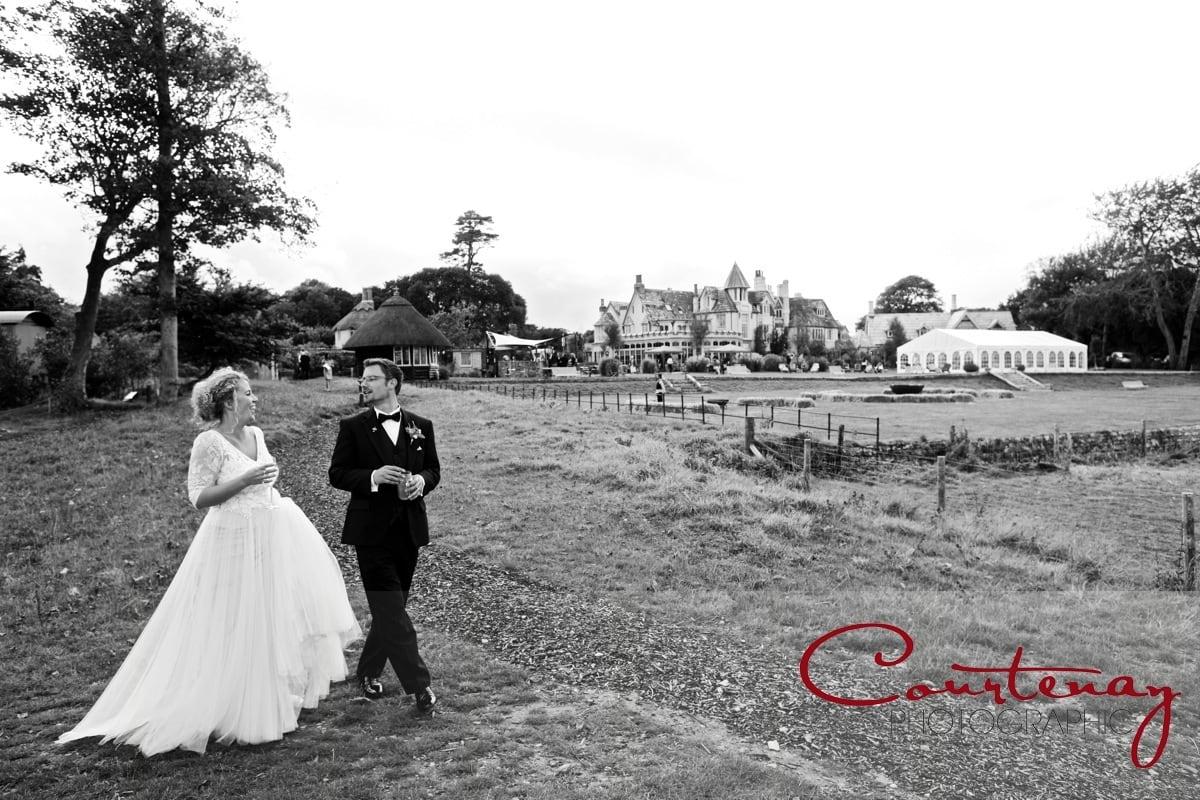 happy couple take a walk Pig on the Beach wedding
