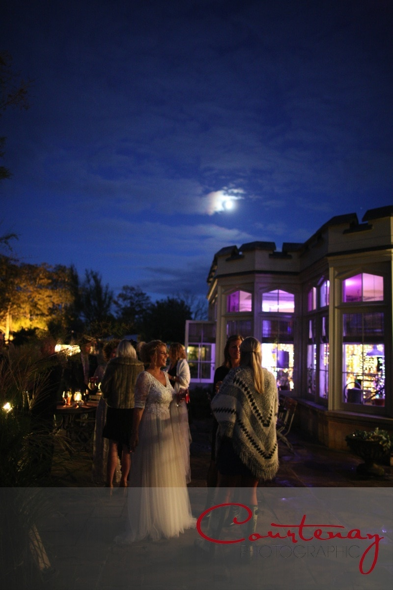 bride outside the pig hotel in evening reception