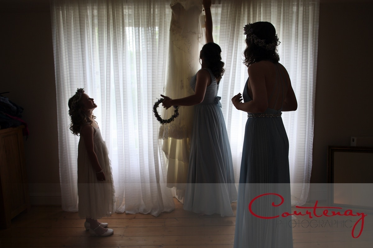 bridesmaids collect the wedding dress