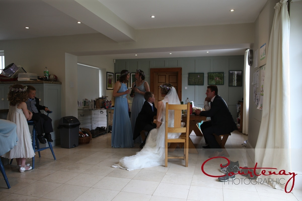 bride waits calmly in the kitchen