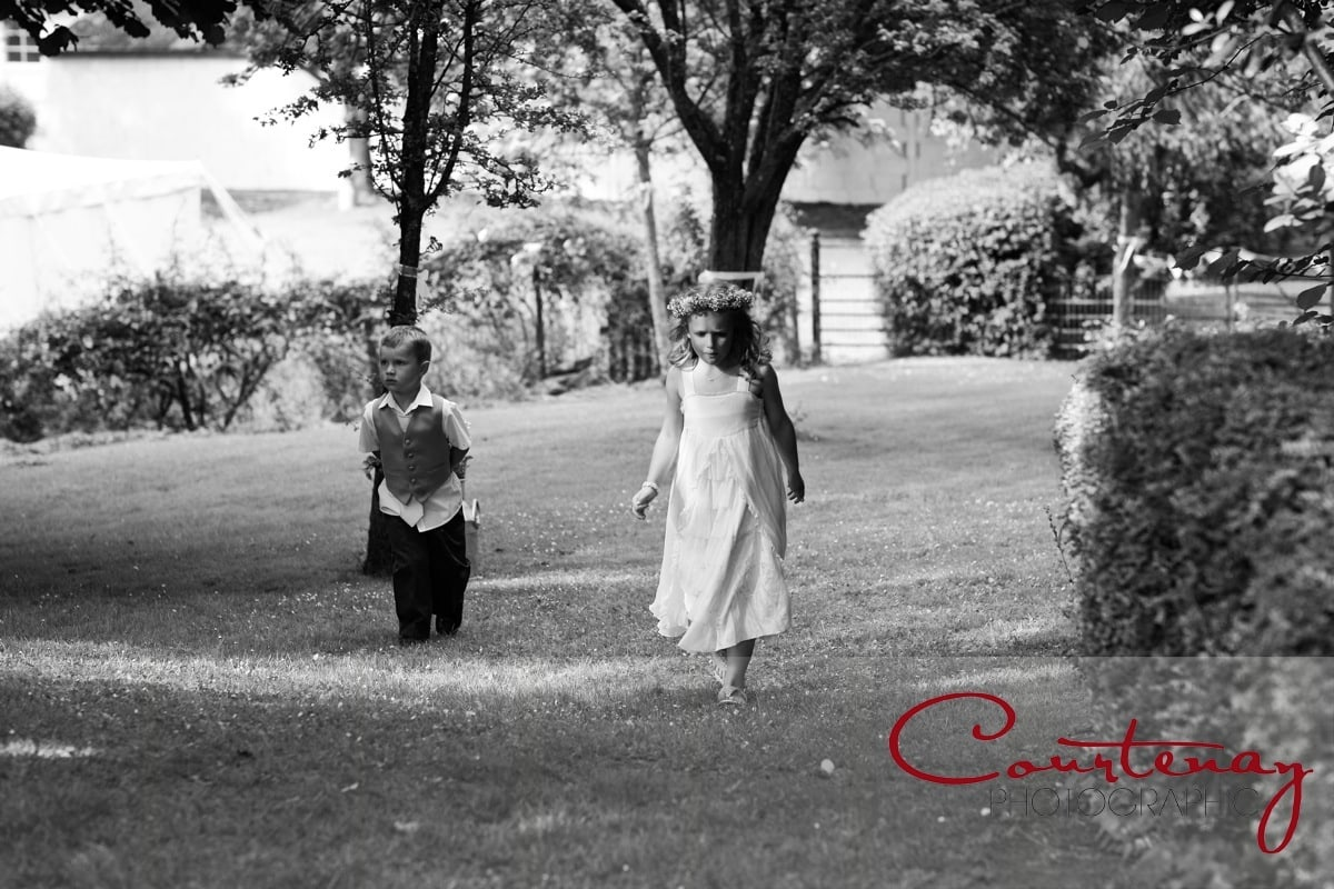 bridesmaid and pageboy enter gardens