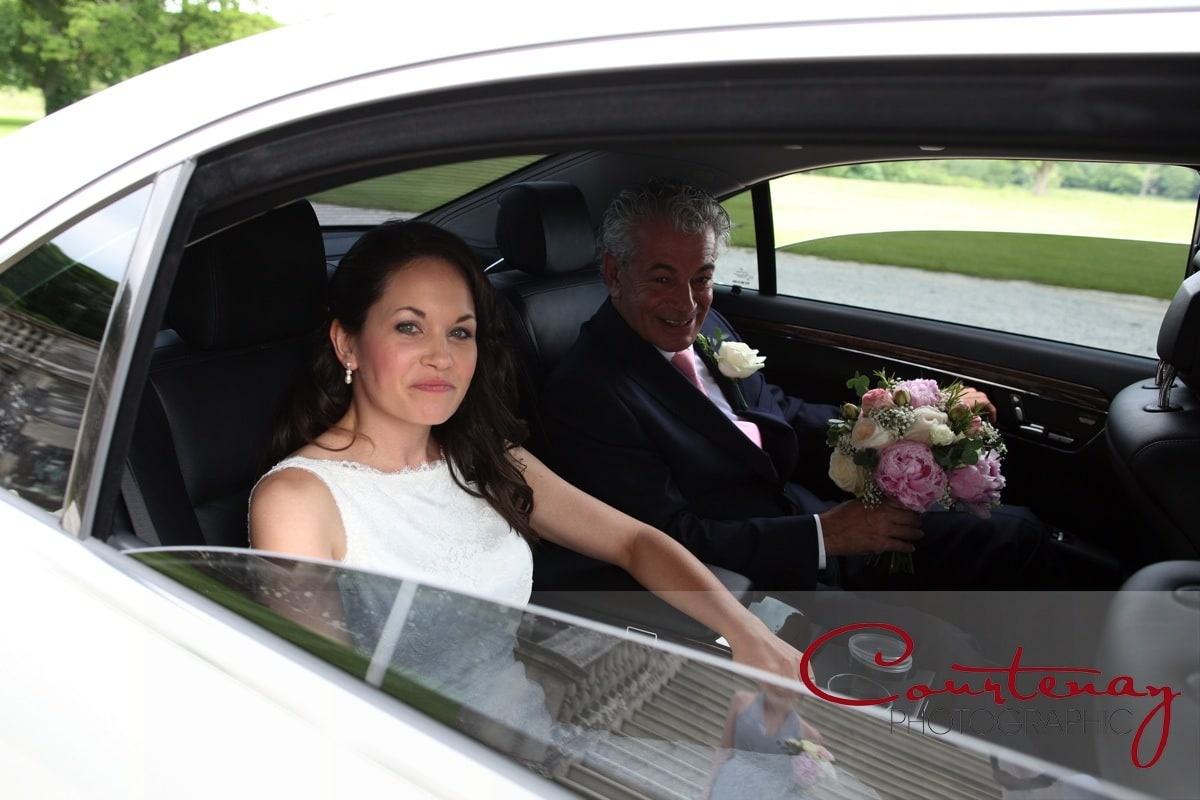 Bride and her father in wedding car