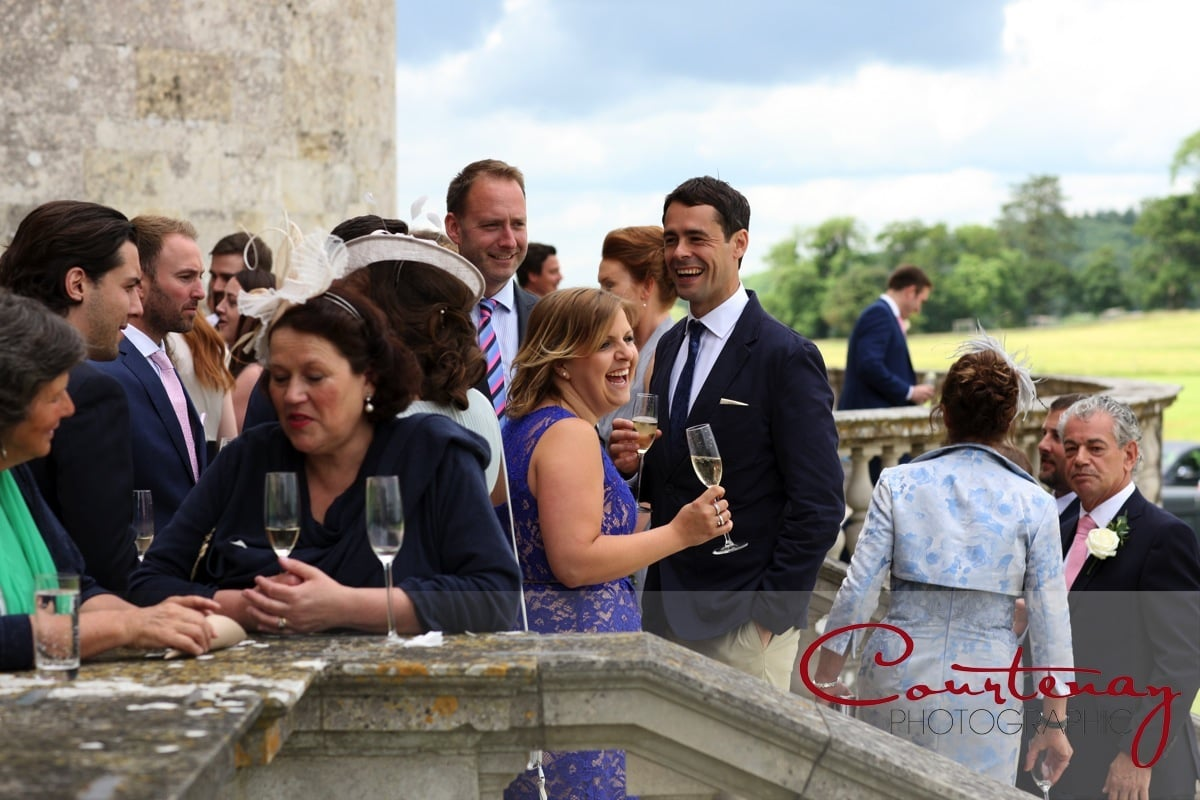 guests enjoy drinks and canapes