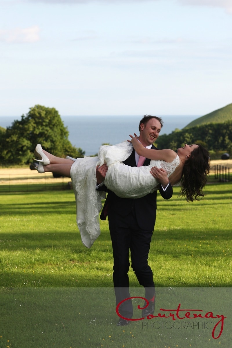 groom gives his bride a lift