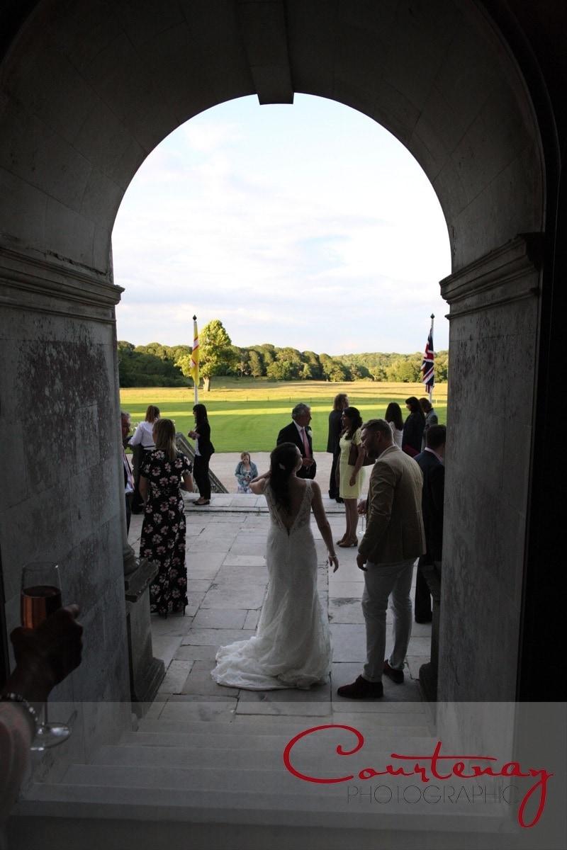 evening wedding guests arrive