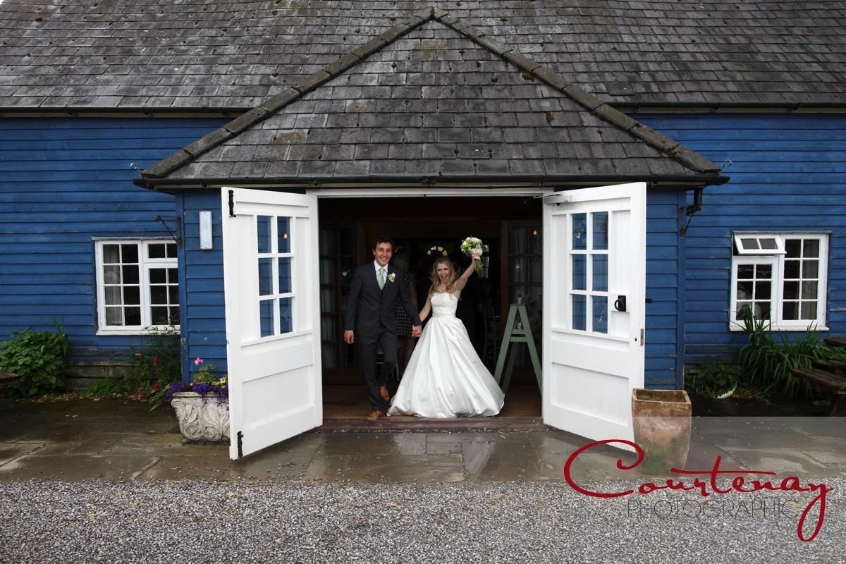 bride and groom exit ceremony barn