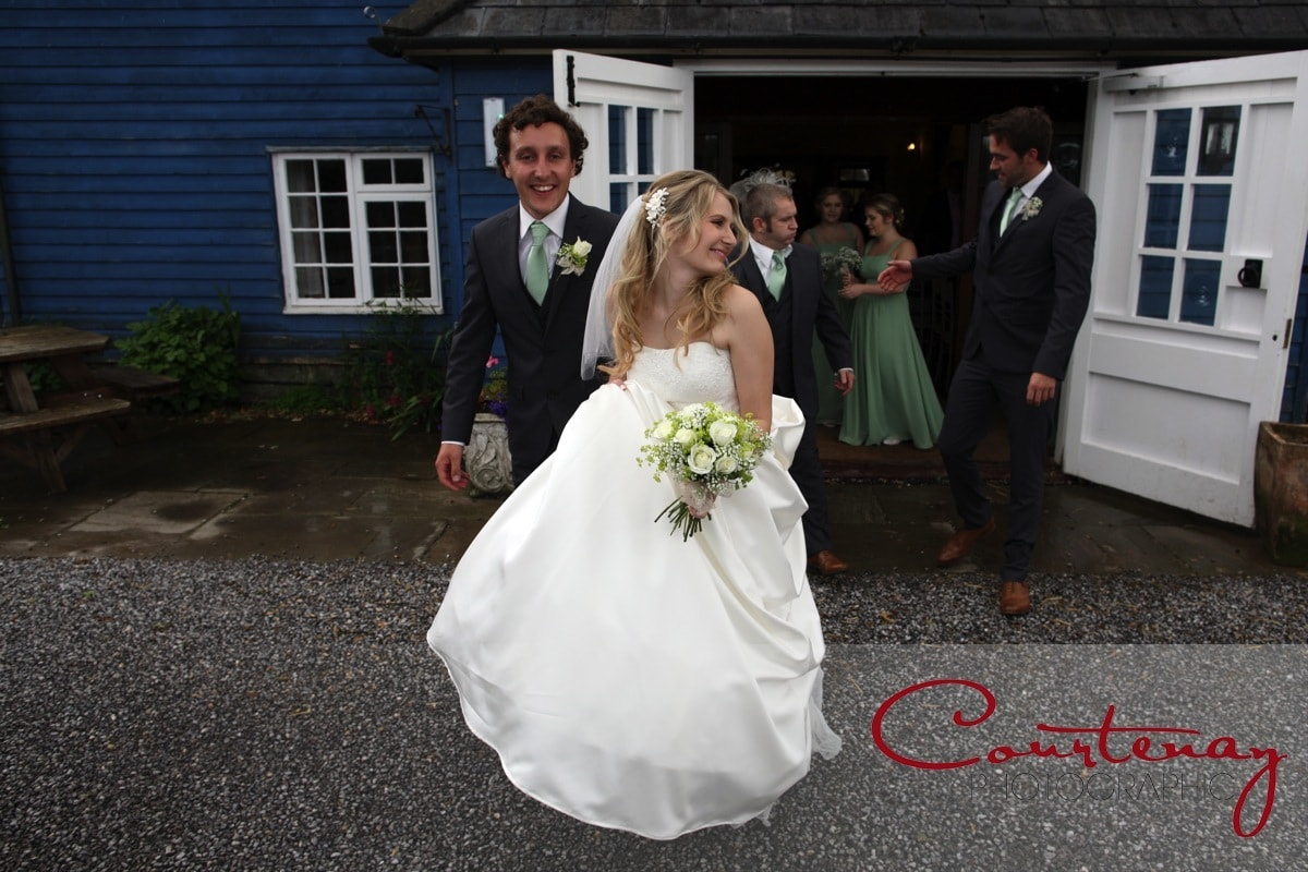 bride and groom head to drinks reception