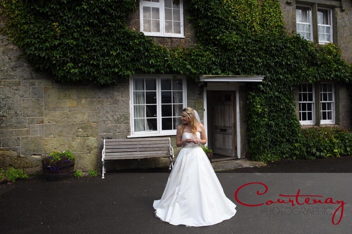bride outside wedding venue