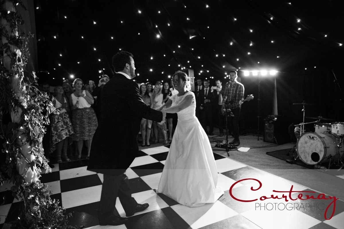 bride and groom take first dance
