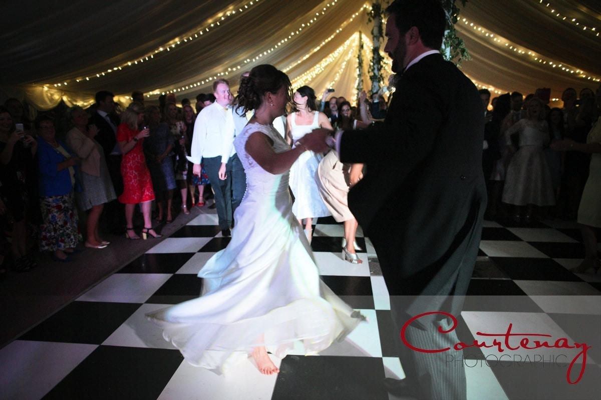 bride and groom are joined on the dance floor
