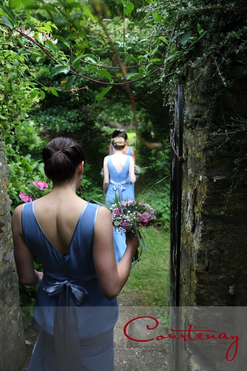 bridesmaids enter the garden