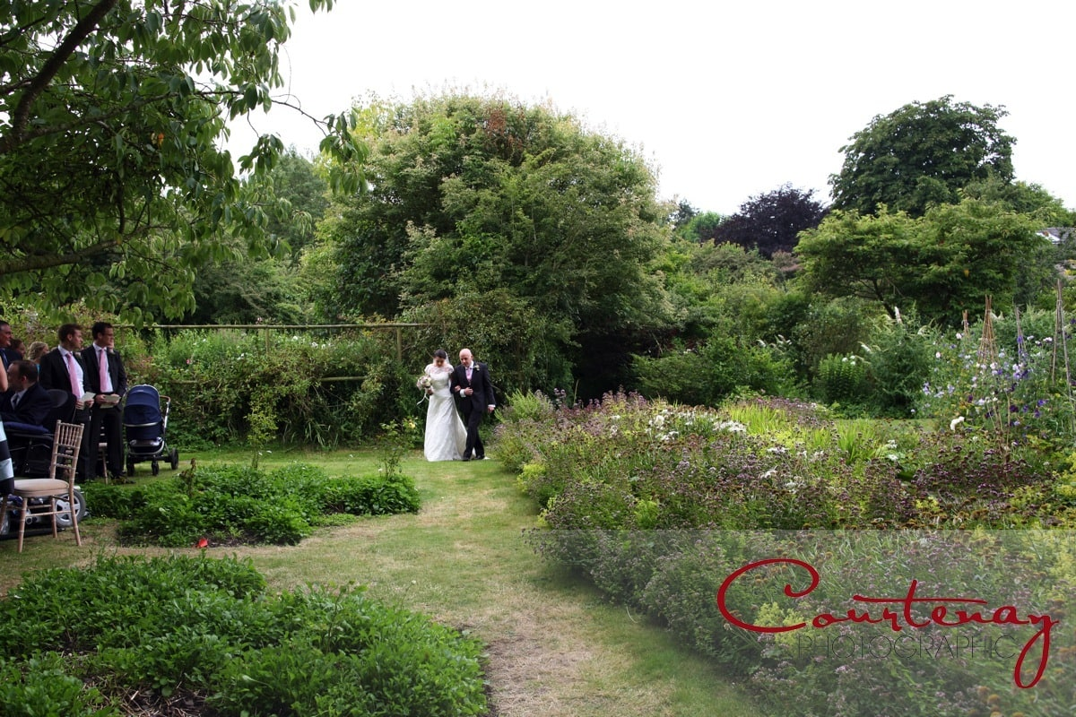 bride and dad process into garden