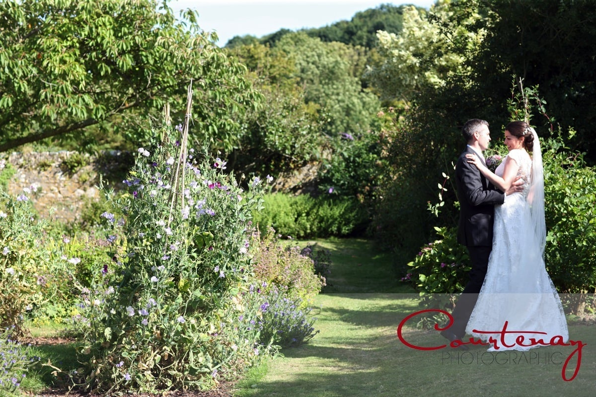 bride and groom enjoy the gardens