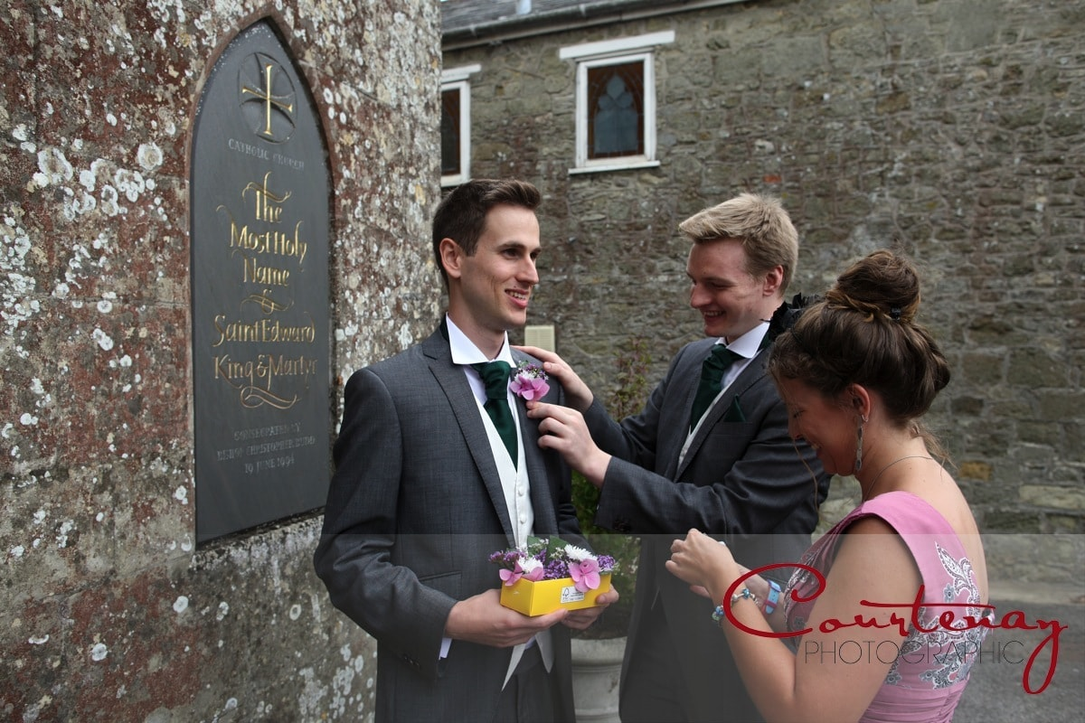 groom gets his button hole