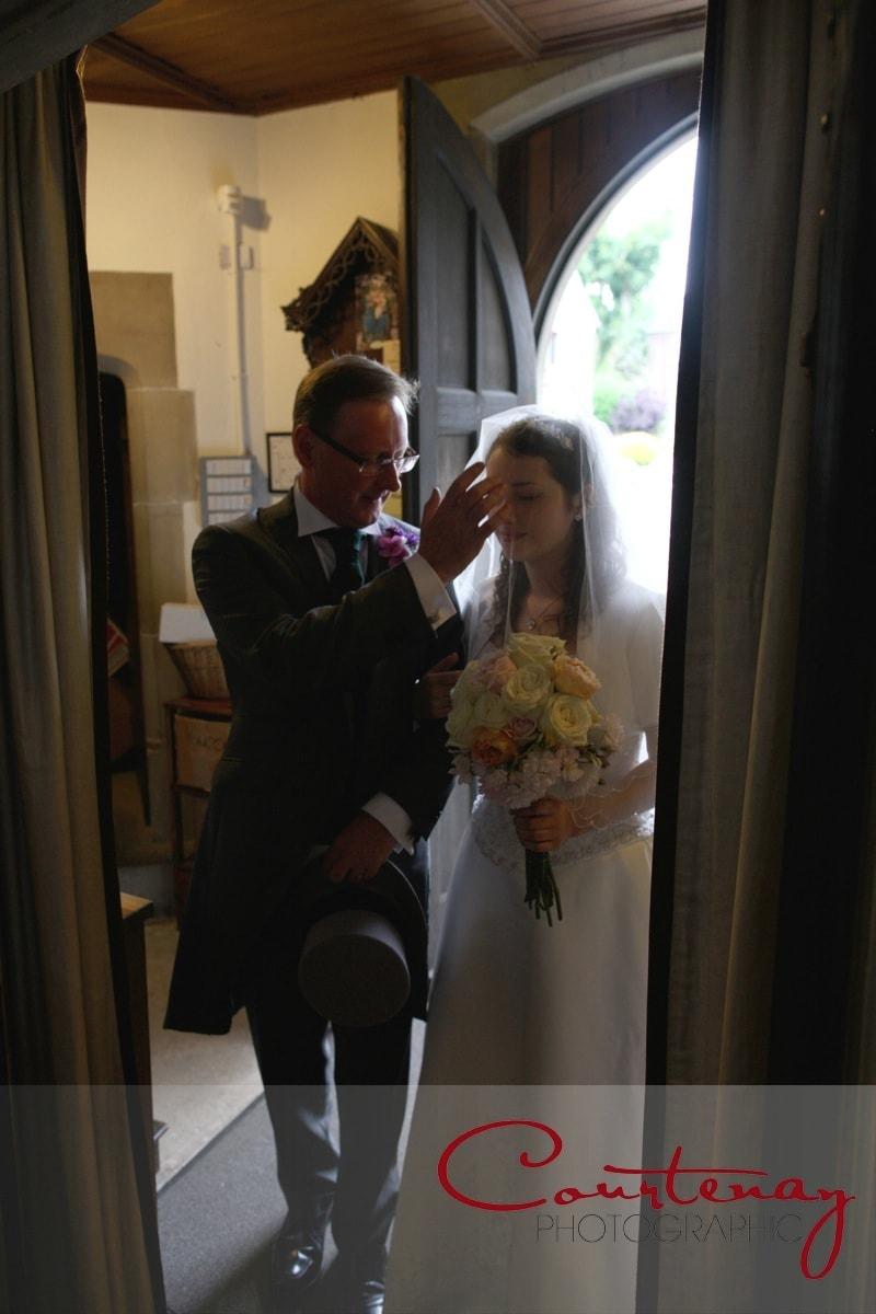 bride and father prepare to enter church