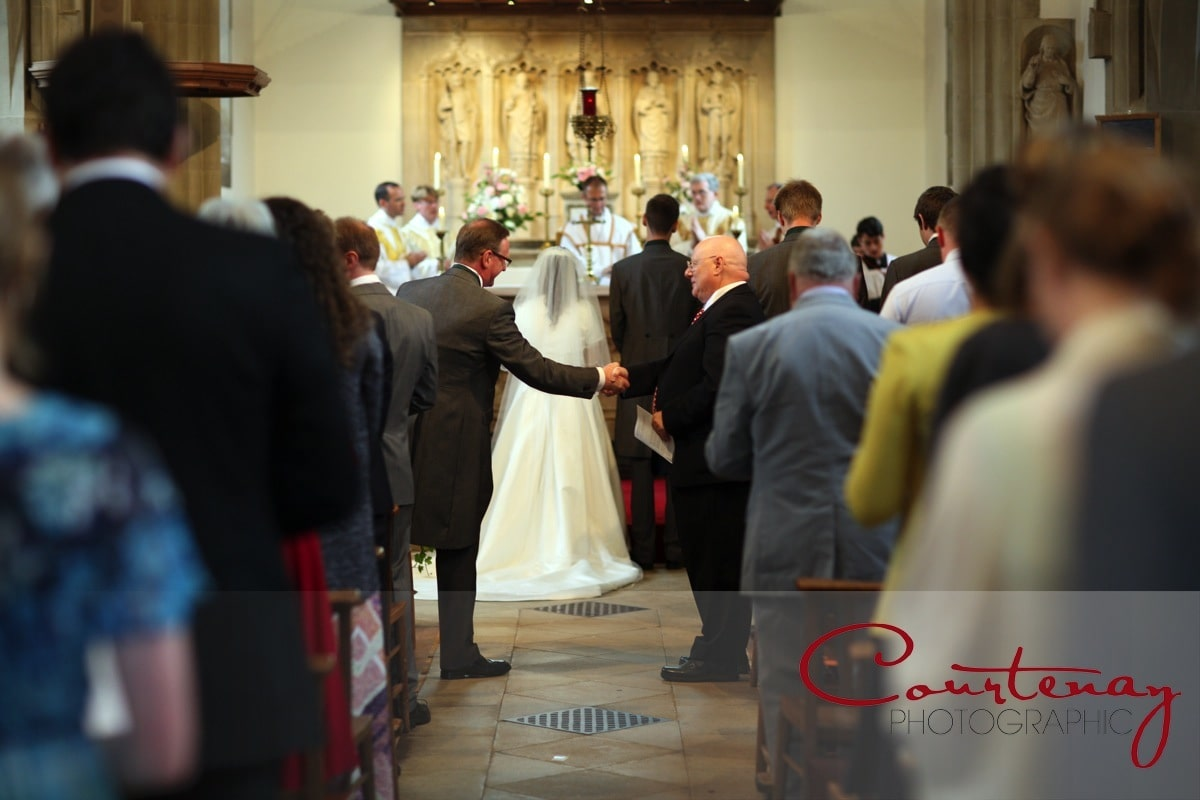 fathers shake hands in church service